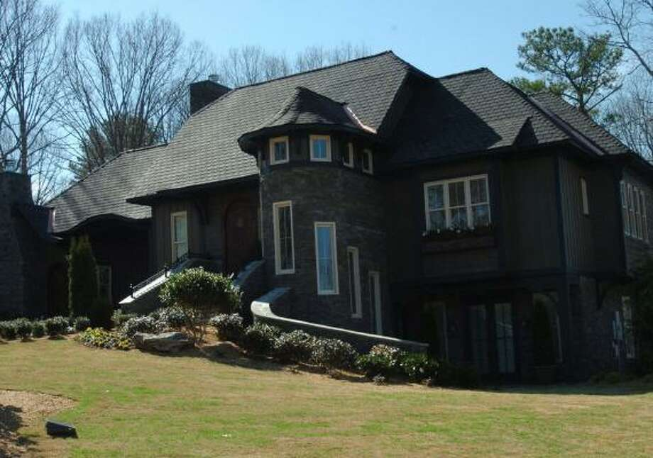 More than 1,800 volunteers helped Extreme Makeover: Home Edition demolish and rebuild the Harper family home in Lake City, Ga. The home is now in foreclosure. Photo: JOHNNY CRAWFORD, ATLANTA JOURNAL CONSTITUTION | ASSOCIATED PRESS