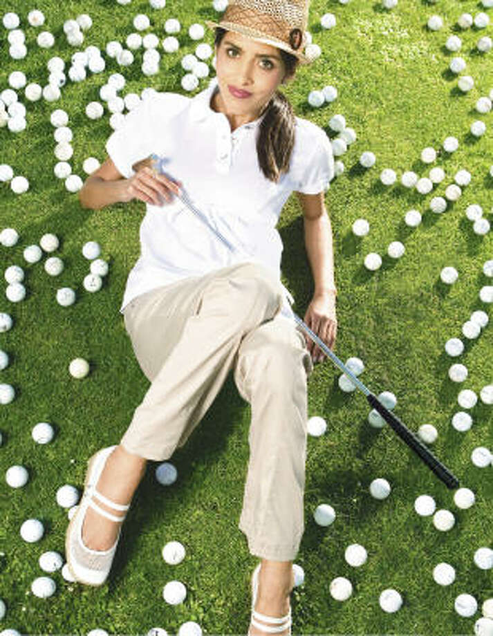 Adidas by Stella McCartney jacket, $160; smock tank, $70, woven pants, $150, Garbato shoes, $160, www.shopadidas.com; Tiffany putter, $1,500, Tiffany & Co. Photo: Billy Winters Photography