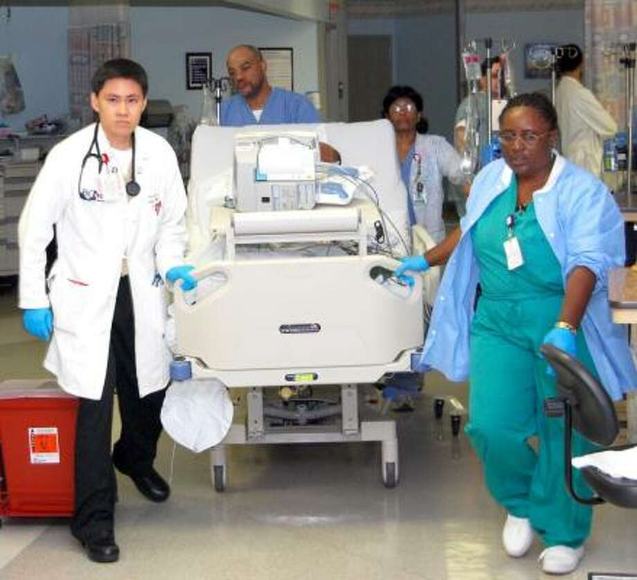 On the Michael E. DeBakey VA Medical Center's Medical Intensive Care and Cardiac Care Units, 17 critically ill patients were carefully moved during the hurricane to the windowless Post-Anesthesia Care Unit during the night.  From left, Charles Lee, M.D., resident; Leroy Beck, R.N., Nursing Unit 3C nurse manager; Ayleamma George, R.N., Cardiac Care Unit staff nurse; and Lucy Lacy, R.N., Catheterization Laboratory nurse manager.