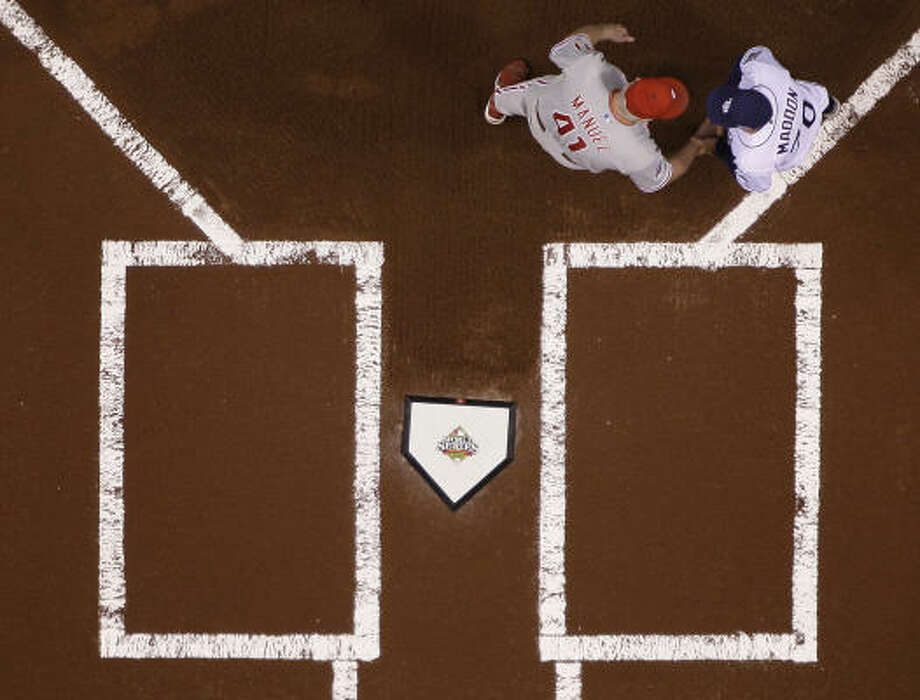 Joe Maddon (right) and the Rays give hope to any team that ever lost 100 games in a season. Photo: David J. Phillip, AP
