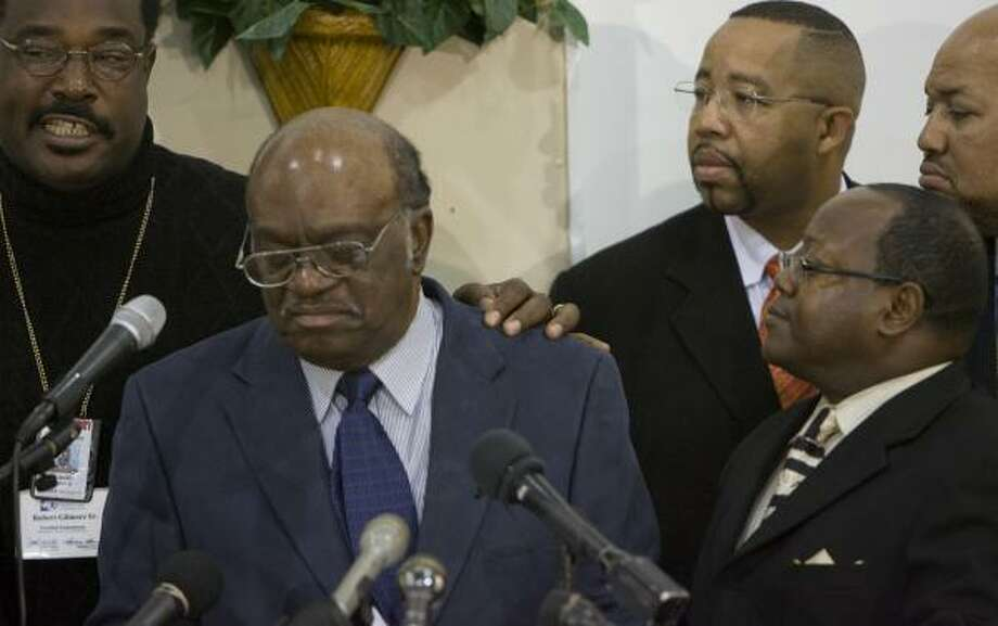 "The Rev. Robert Gilmore, left, joins the Rev. Robert Jefferson, second from left, and other ministers Tuesday to ask local leaders to take steps to end the violence affecting black youths. ""We're tired of black-on-black violence,"" Jefferson said. Photo: Johnny Hanson, Chronicle"