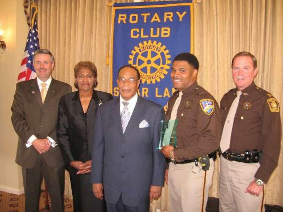 Joining Sugar Land Rotary President Scott Finley at the recognition event are Shirley Davis, Frank Davis Sr.; Frank Davis Jr.; and Capt. Mike Patton of the Fort Bend County Sheriff\u0092s Office.