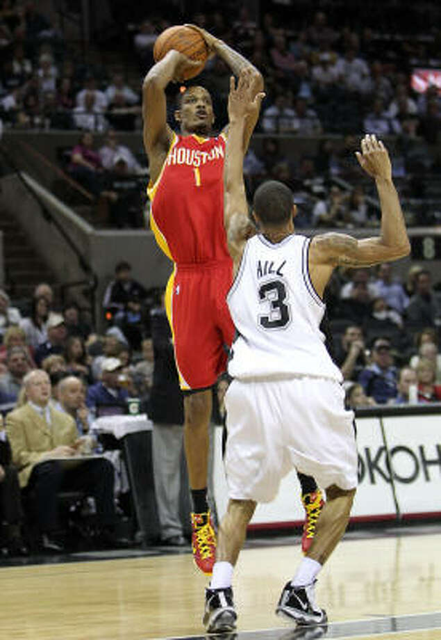 The Rockets' Trevor Ariza elevates for a shot over San Antonio's George Hill. Photo: Ronald Martinez, Getty Images