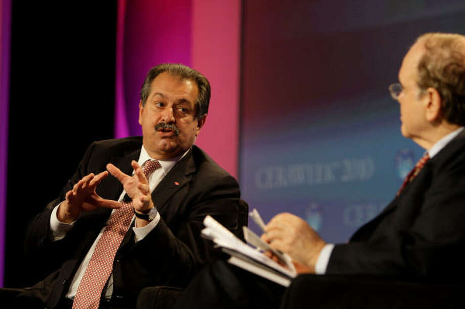 Andrew Liveris, left, Dow Chemical Co.'s CEO, speaks with Daniel Yergin, chairman of IHS CERA, during a Q&A session on Thursday. Photo: Melissa Phillip:, Chronicle