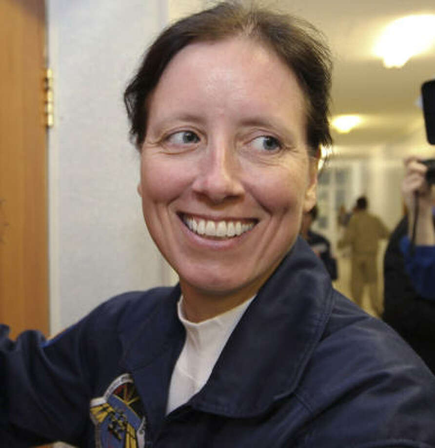 Shannon Walker is Houston's first native astronaut. Photo: Sergei Remezov, Associated Press