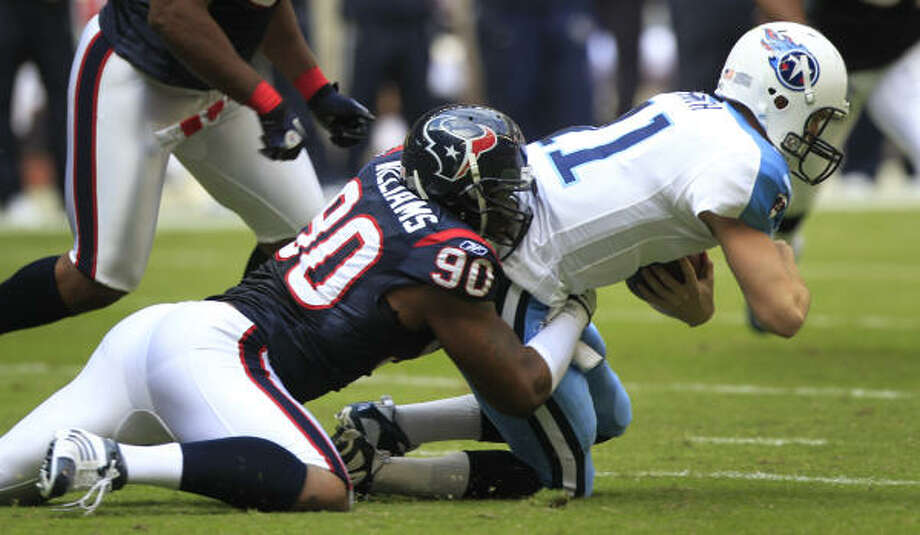 Texans defensive end Mario Williams sacks  Titans quarterback Rusty Smith on Nov. 28. Photo: Brett Coomer, Chronicle