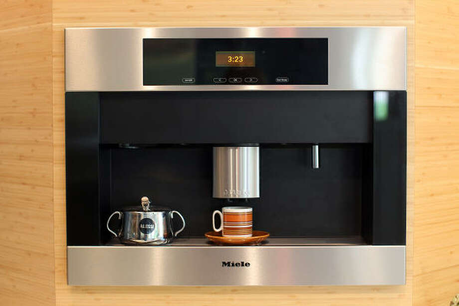 Every wish list needs an extravagent item. For the kitchen, a built-in coffee maker is an indulgence that cooks will appreciate after the basic needs are met. Photo: Jennifer Whitney