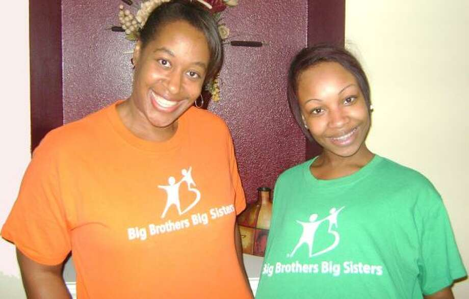 "Angela Dixon, left, with her ""little sister"" Jamalia Williams."