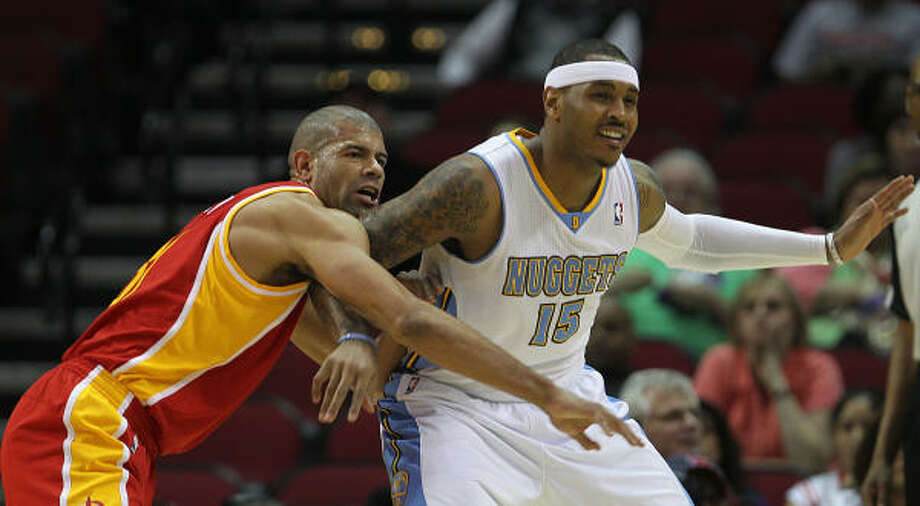 The Rockets would love to have Carmelo Anthony, right, even though he didn't fare well against Shane Battier on Monday night. Photo: James Nielsen, Chronicle