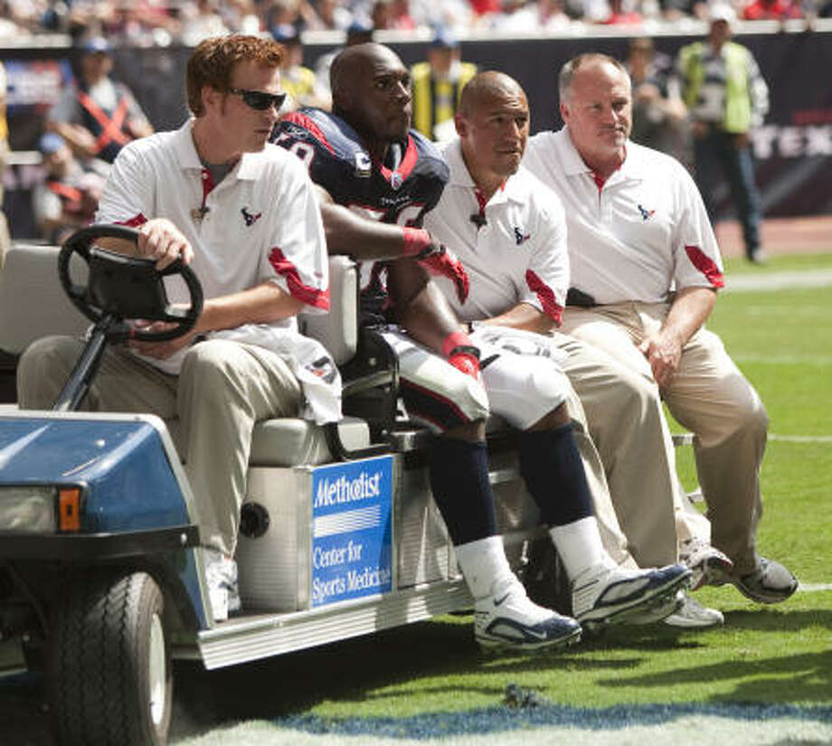 After suffering a torn Achilles' tendon, Texans linebacker DeMeco Ryans is carted off the field at Reliant Stadium on Oct. 17, bringing his season to a close. Photo: Brett Coomer, Chronicle