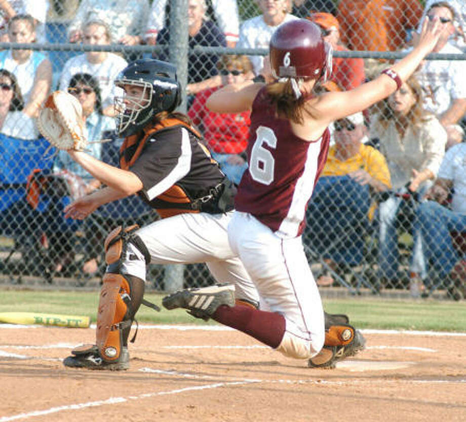 Emily Meurer (right) and Cinco Ranch came back from an 0-1 deficit to win the series with Alvin. Photo: Kirk Sides