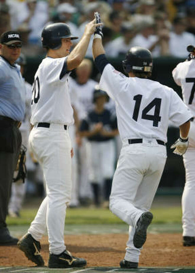 Rice's Joe Savery, left, and Jess Buenger had plety of reason to celebrate during the Owls' six-run eighth inning that sank Louisville. Photo: Kevin Fujii, Chronicle