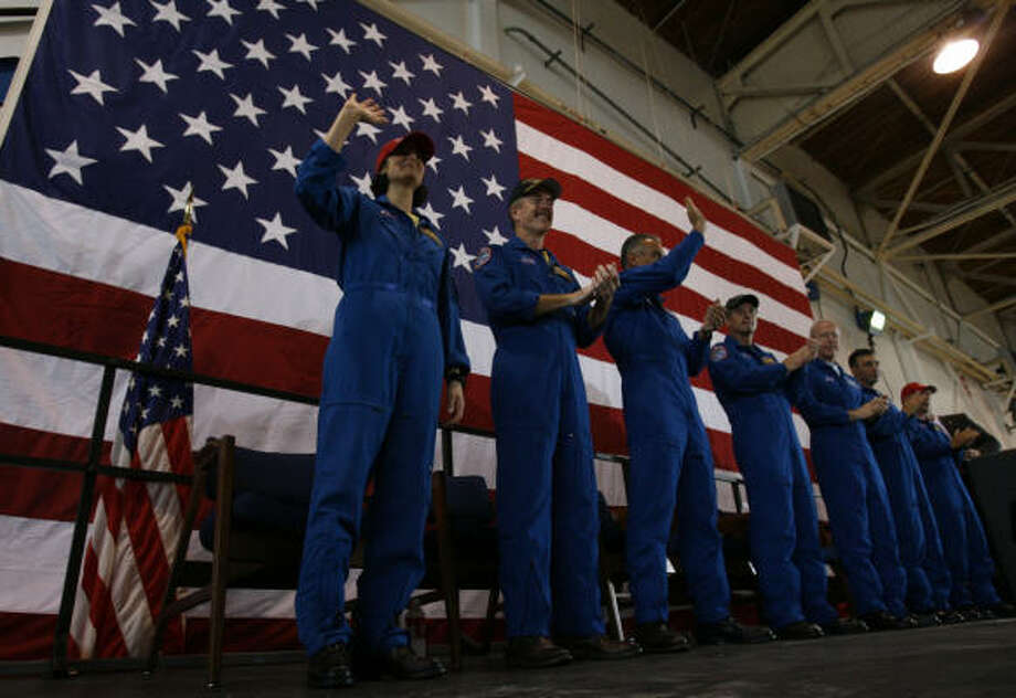 "Atlantis STS-117 crew Sunita ""Suni"" Williams, left, Jim Reilly, Danny Olivas, Patrick Forrester, Steven Swanson, pilot Lee Archambault, and commander Frederick ""Rick"" Sturckow, right, at a welcoming ceremony. Photo: Melissa Phillip, Chronicle"
