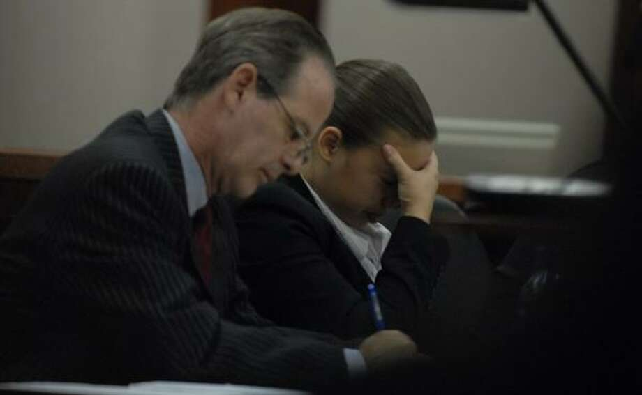 Ashley Benton, with attorney Brian Wice at her side, takes a moment during her murder trial  Monday. Photo: TONY BULLARD, FOR THE CHRONICLE