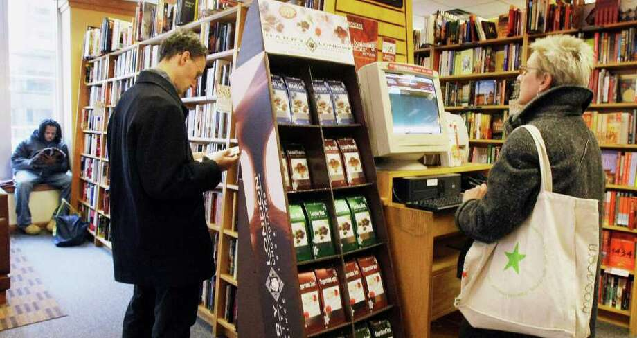 Shoppers are seen inside a Border's bookstore in Chicago's Loop on Wednesday, Nov. 19, 2008. Prices made the biggest monthly decline on record in October, giving shoppers a reprieve but raising fears of deflation, which could hammer companies and make a recession spiral into something worse. (AP Photo/Charles Rex Arbogast) Photo: Charles Rex Arbogast, STF / AP