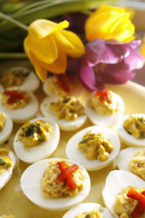 Curried Eggs and Green Olive Eggs With Roasted Peppers are tasty ways to stuff leftover Easter eggs. Photo: Kevin Fujii, Chronicle