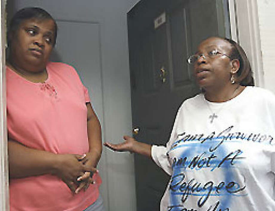 At home in Houston, Anna Thomas, left, and Phyllis Riley recall their experiences in New Orleans on Tuesday, the day before the second anniversary of Hurricane Katrina. Photo: Melissa Phillip, Chronicle