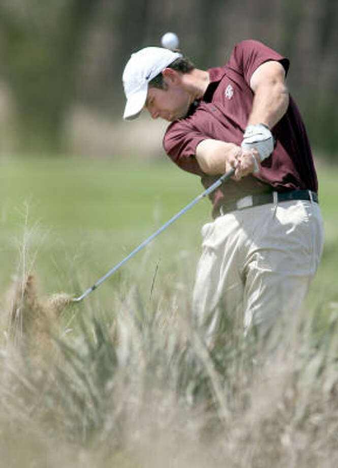 Texas A&M's Robert Gates hits out of the rough on the 13th hole during the second round of the Big 12 golf championship. Photo: Travis Morisse, AP