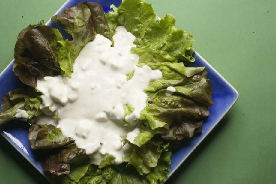 HOMEMADE TASTE:Mayonnaise and buttermilk turn blue cheese into a delicious salad dressing. Photo: Buster Dean, Chronicle