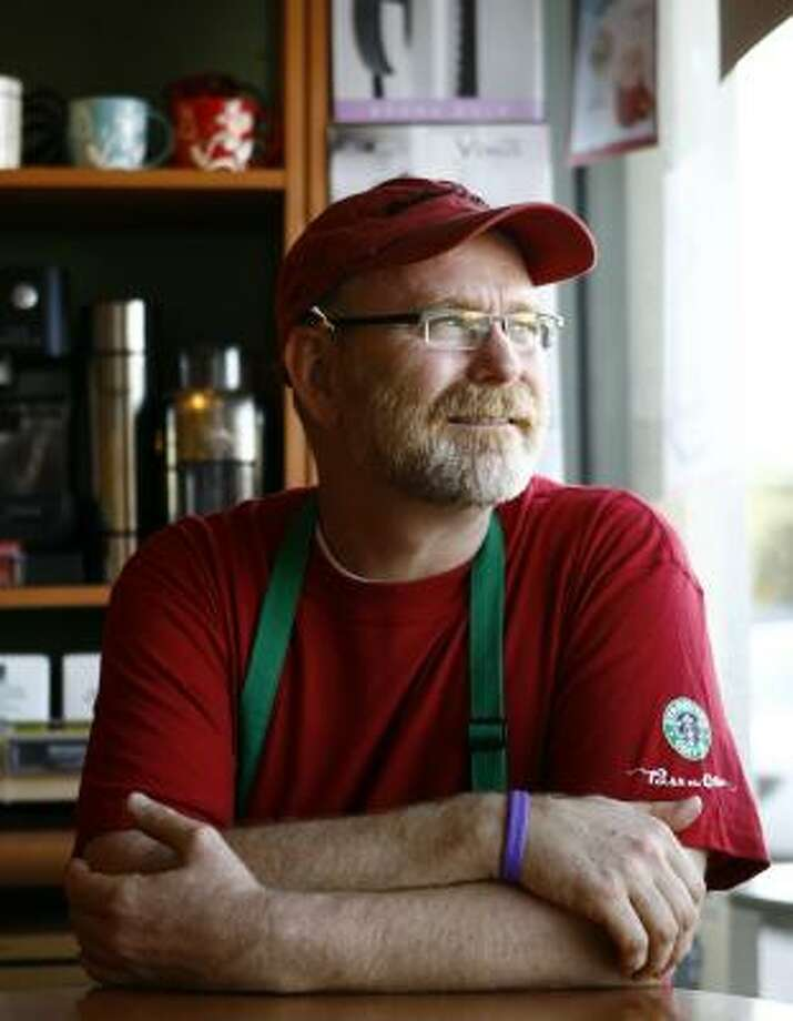 Jim Bradley is manager of the Highland Village Starbucks, the coffee shop chain's first Houston location. Photo: NICK De La TORRE, CHRONICLE