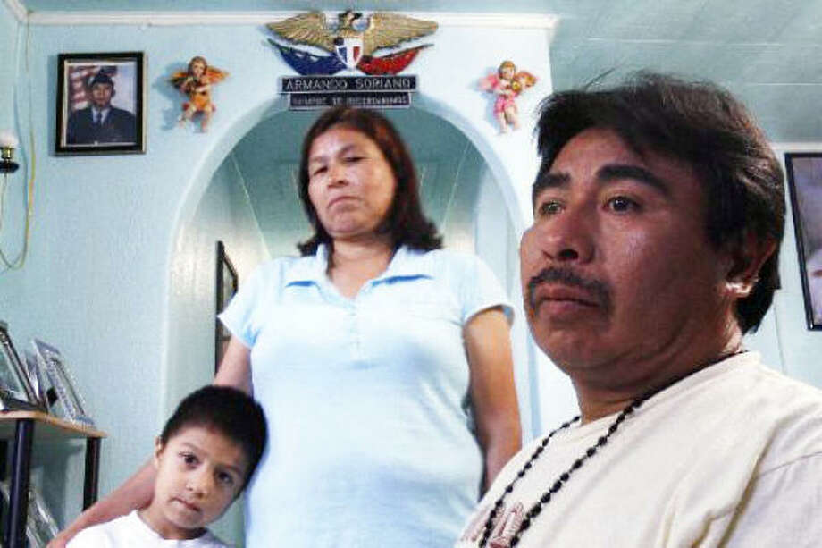 Enrique Soriano, right, is facing deportation that would separate him from hiw wife, Cleotilde and his children, including son Kevin, 6, left. The family's oldest son, Armando, died in Iraq in 2004. Photo: Nathan Lindstrom, For The Chronicle