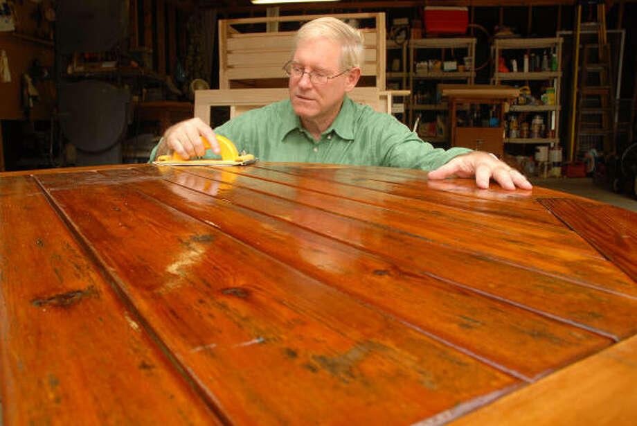 Robert Strauss sands a patio table he built for his home in The Woodlands. Strauss builds furniture and other fine wood products as his hobby. Photo: David Hopper, For The Chronicle