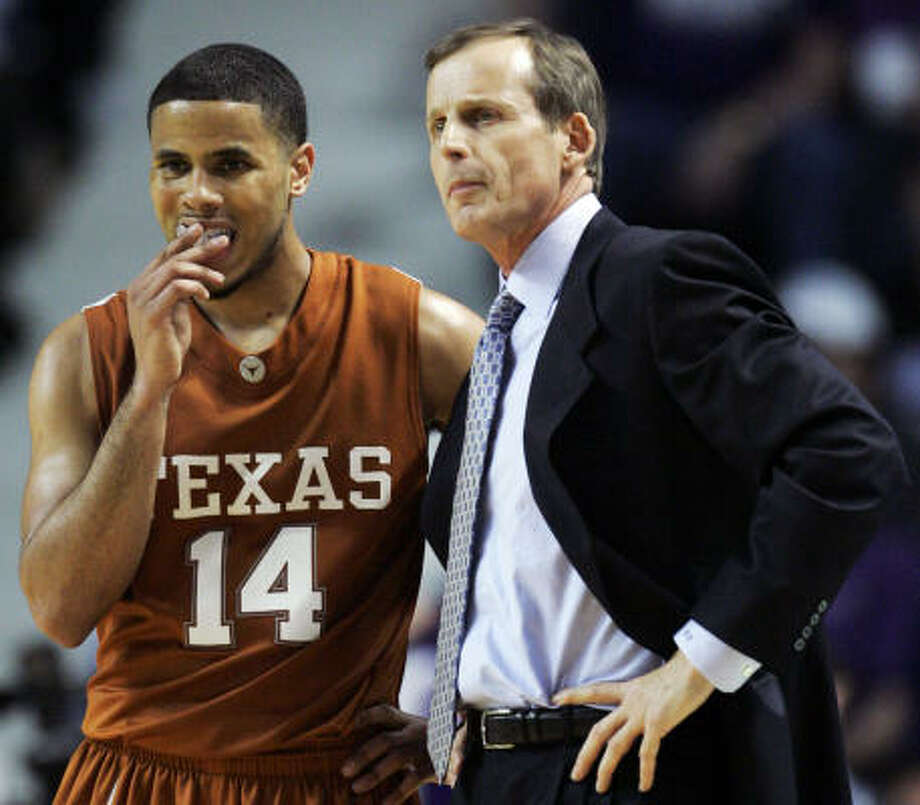 Texas point guard D.J. Augustin, left, has knowledge that extends well beyond the basketball court. Photo: Orlin Wagner, AP