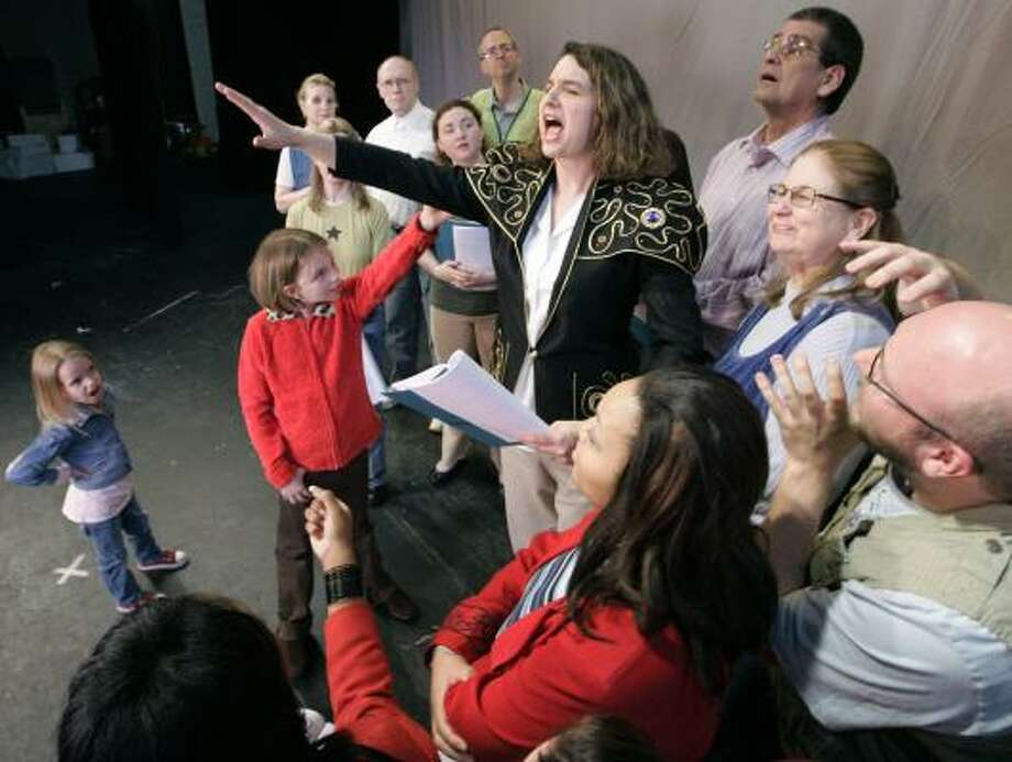As mayor, Jessica Thompson, center, addresses the town. Photo: JOHN AMIS, ASSOCIATED PRESS