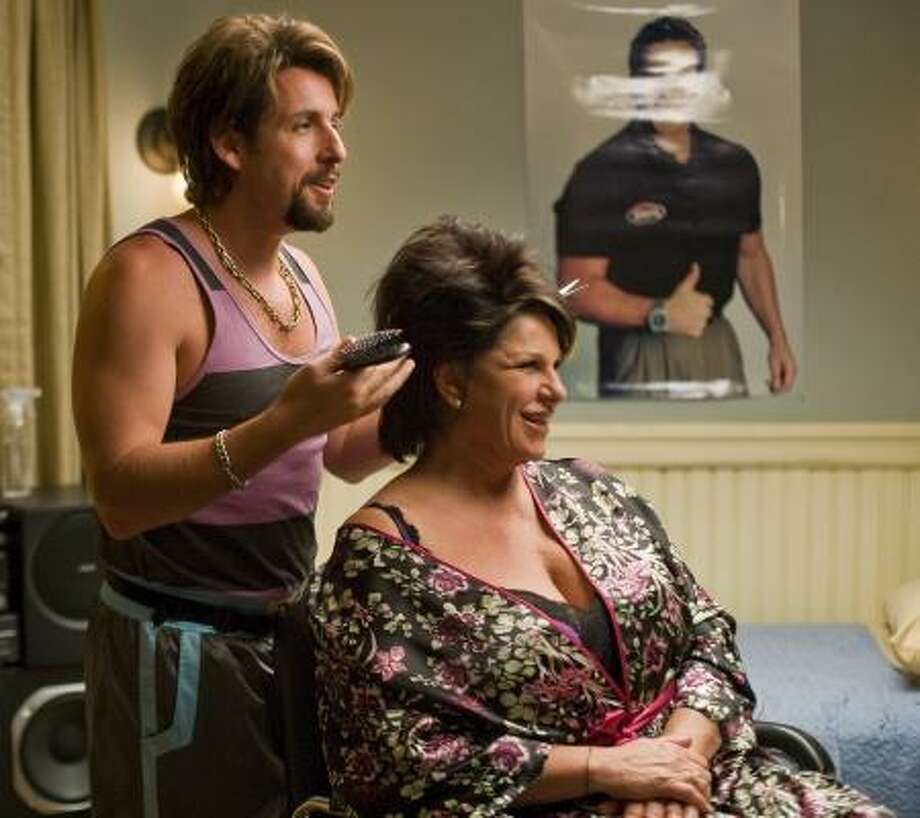 Onetime counter-terrorist and now-hairstylist Zohan (Adam Sandler) practices his technique with Gail (Lainie Kazan) in You Don't Mess With the Zohan. Photo: ASSOCIATED PRESS, COLUMBIA PICTURES | TRACY BENNETT
