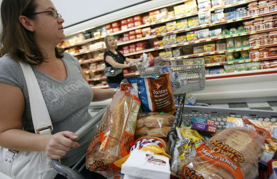 Kristal Kryski shops at the Wal-Mart Supercenter on South Kirkwood. Photo: Sharon Steinmann, Chronicle