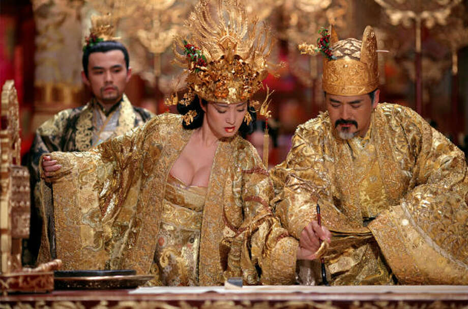 Pince Jie (Jay Chow, left), the Empress (Gong Li) and the Emperor (Chow Yun Fat) in a scene from The Curse of the Golden Flower. Photo: Sony Pictures Classics