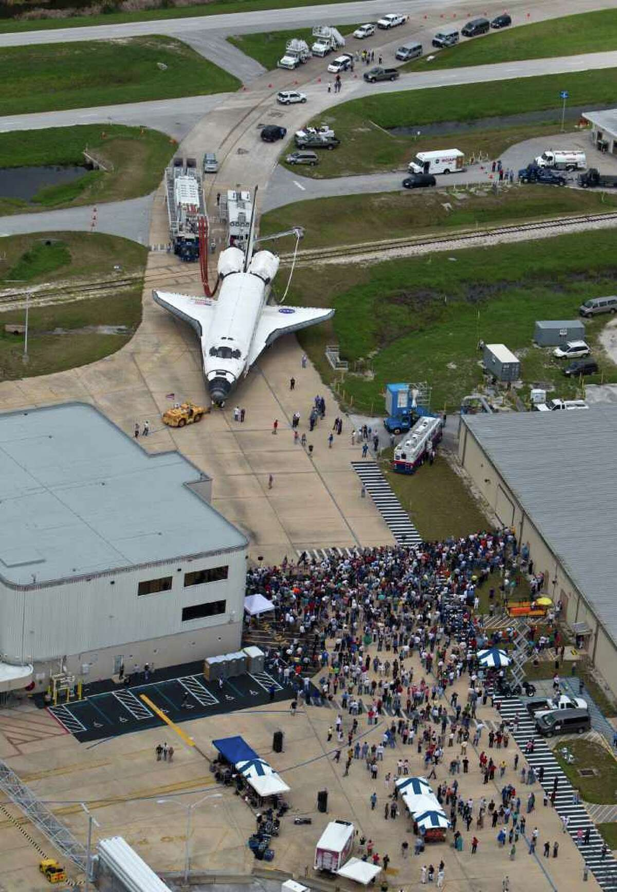The space shuttle Atlantis is towed from the landing strip to the OPF ( Orbiter Processing Facility after completing the final mission of the space shuttle program Thursday, July 21, 2011, in Kennedy Space Center. ( James Nielsen / Chronicle )