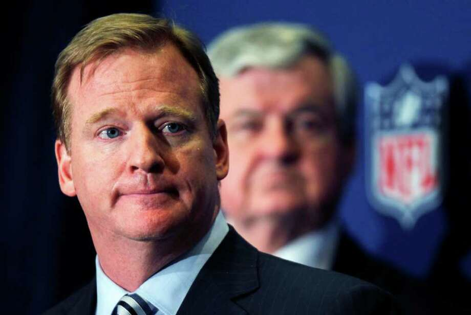 NFL commissioner Roger Goodell announces that NFL owners have agreed to a tentative agreement that would end the lockout pending the players approval on Thursday, July 21, 2011, in College Park, Ga. Carolina Panthers owner Jerry Richardson looks on in the background.  (AP Photo/John Bazemore) Photo: John Bazemore, STF / AP