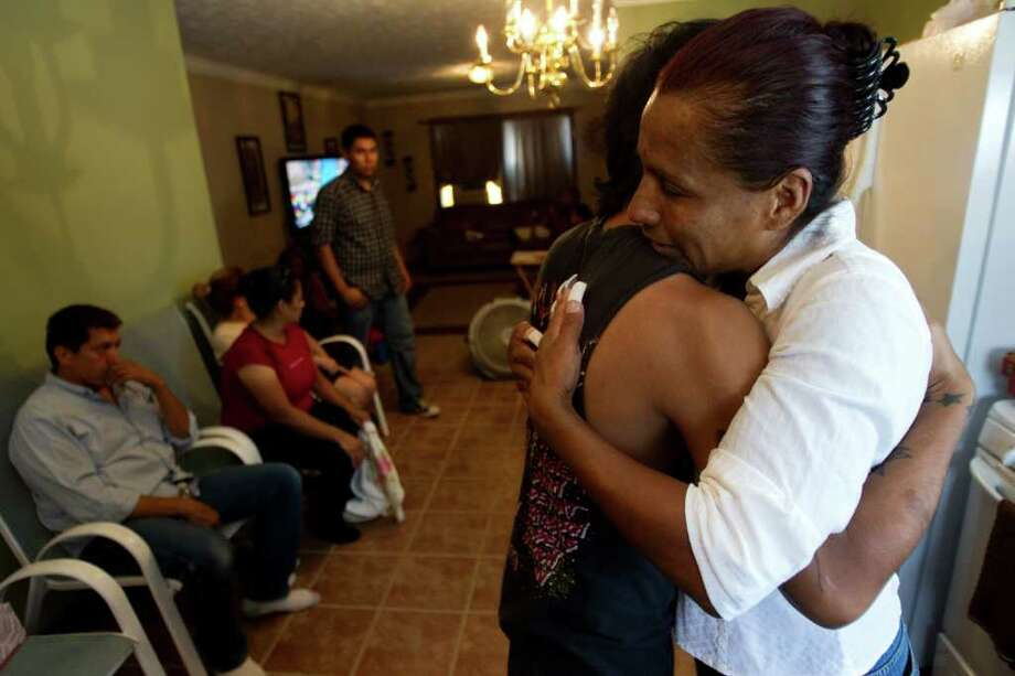 Janie Torres, right, mother of Army Sgt. Jacob Molina, embraces her son Richard Molina, Jr., as the family gathers to grieve the loss of Sgt. Torres Thursday, July 21, 2011, in Houston. Sgt. Molina, 27, died July 19 in Kunar Province, Afghanistan, of wounds suffered in a roadside bombing. ( Brett Coomer / Houston Chronicle ) Photo: Brett Coomer, Staff / © 2011 Houston Chronicle