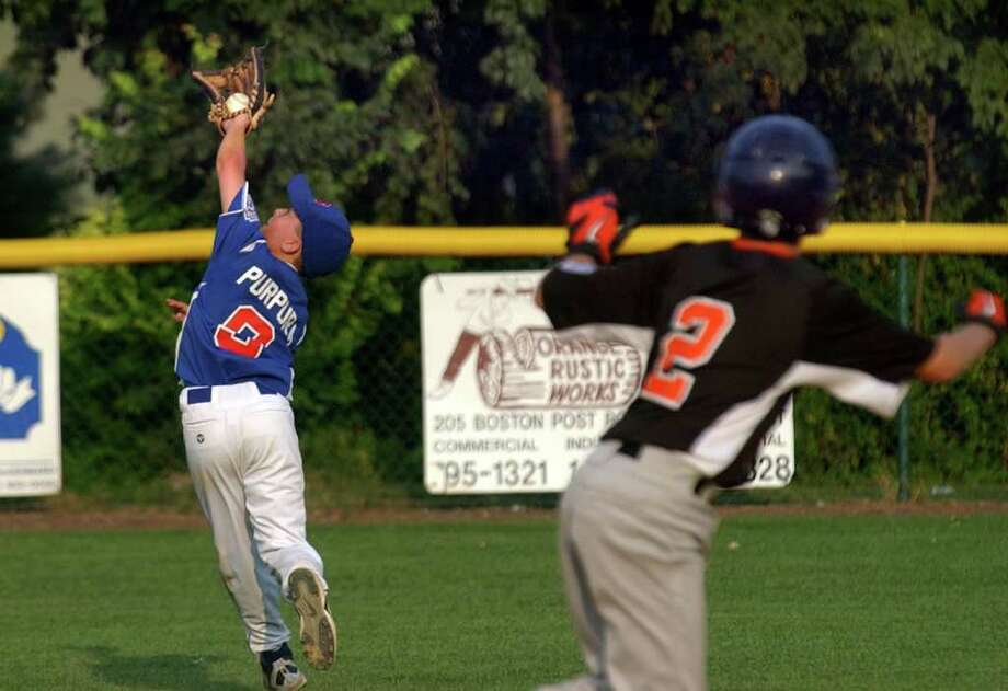 North Stamford's #9 Grant Purpura makes a behind the shoulder catch, during little league baseball sectional action against Shelton National in Orange, Conn. on Thursday July 21, 2011. Photo: Christian Abraham / Connecticut Post