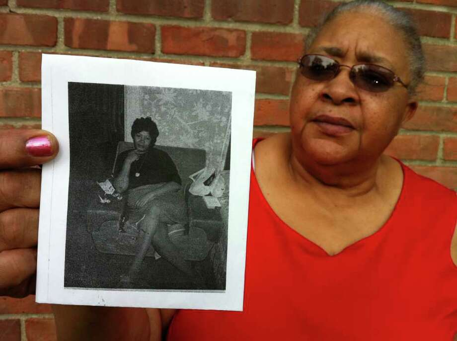 Stamford resident Earlean Hines holds a photograph of her sister Carrie Lee Mock, also of Stamford, who was found murdered in Greenwich on July 19, 1981. Greenwich Police are once again looking at the cold case. Photo: Frank MacEachern