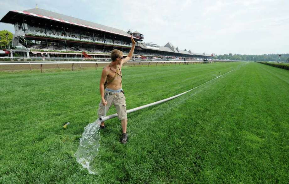 Anthony Corbin of Mechanicville tests the water in the sprinkler system on the turf course at the Saratoga Race Course in Saratoga Springs, N.Y. July 21, 2011, The 143rd meeting of the historic race track in upstate New York begins tomorrow. (Skip Dickstein / Times Union) Photo: SKIP DICKSTEIN / 00013968A