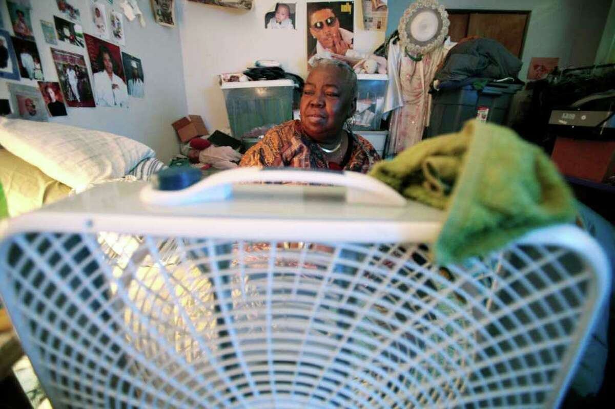 Mary Ware sits still on her bed next to the fan while waiting for a ride for dialysis Thursday, July 21, 2011 in Chicago. Ware, 62, who suffers from high blood pressure and diabetes and requires dialysis three times a week, lives in a basement Chicago apartment with her son and daughter. She receives disability income but can?'t afford air-conditioning. Thousands of low-income people across the nation are having trouble paying their electric bills during this sweltering summer because the assistance normally available isn?'t there after Congress cut millions of dollars used for the program. (AP Photo/Kiichiro Sato)