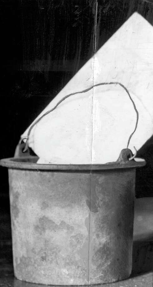 A seattlepi.com archive photo of the glue pot that started the Great Seattle Fire of 1889. It's now kept at the Museum of History and Industry. Photo: Seattlepi.com File