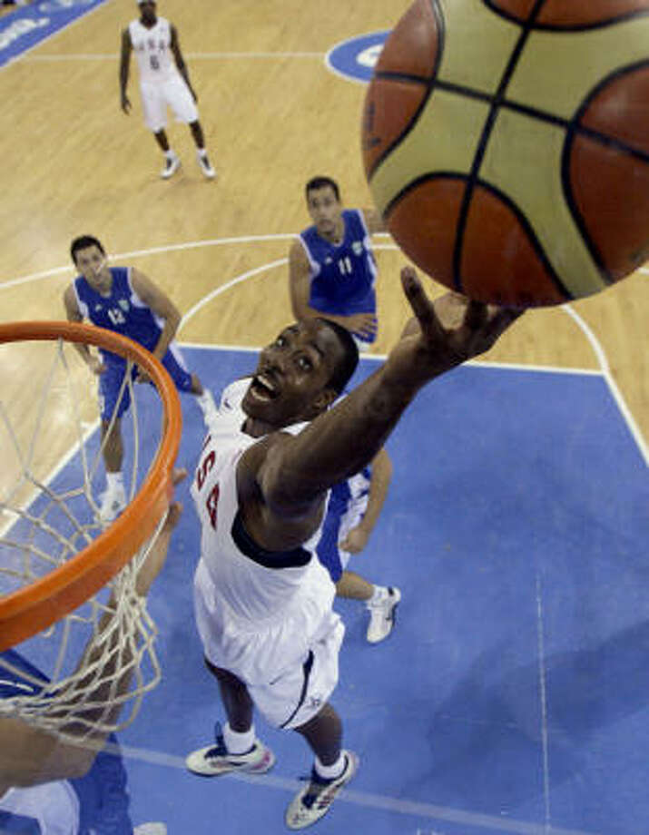 Dwight Howard tries to get a rebound. The United States and Greece each had 38 of them in Thursday's game. Photo: Dusan Vranic, AP