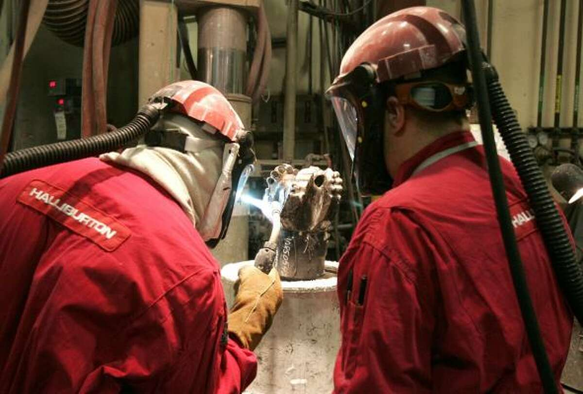 Employees of Security DBS Drill Bits, a unit of Halliburton, work in the company's plant in The Woodlands.