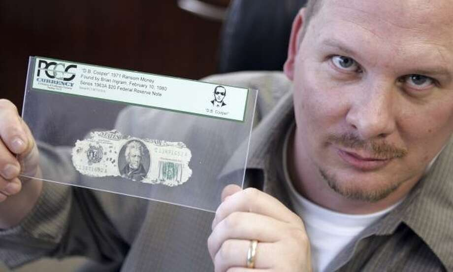 Brian Ingram, now 36, was 8 years old when he found the money during a family camping trip near Portland, Ore. Photo: LM Otero, Associated Press