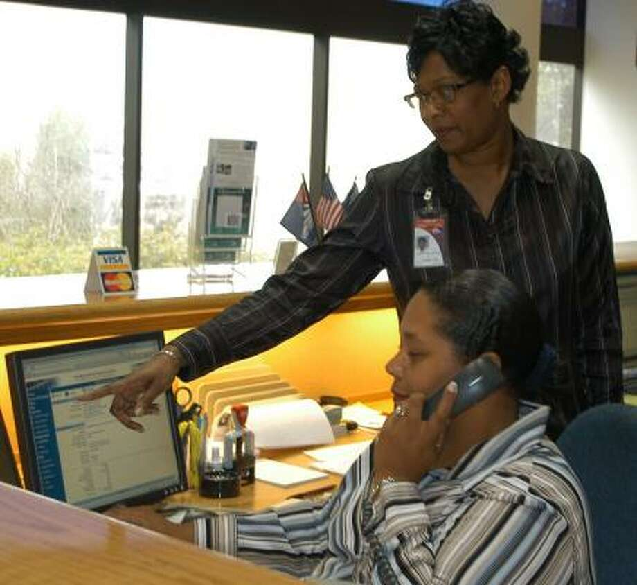 The Missouri City Information Center handles 6,000 calls a month, after nine months of operation. The center was launched with new phone numbers to serve the public as a first point of contact with up-to-date information about city functions and services. Teresa Millhouse, standing, and Kimberly Amos help callers.