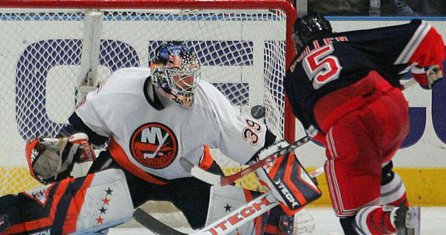 New York Rangers' Matt Cullen (5) puts the puck past Islanders goalie Rick DiPietro during a shootout The Rangers defeated the New York Islanders 2-1 Photo: Ed Betz, AP