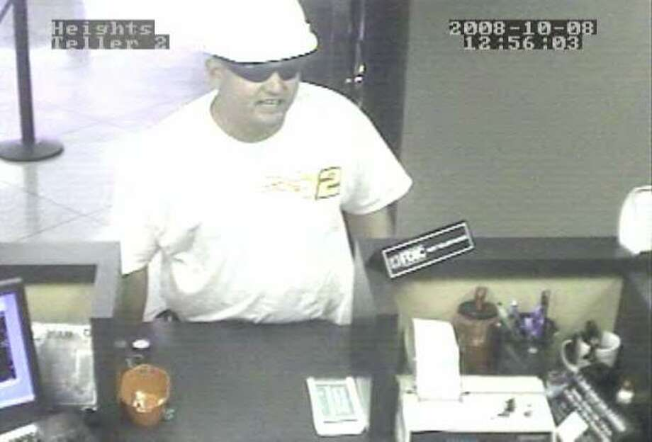 The man threatened tellers with a pistol Wednesday as he demanded cash at a bank in the Heights and warned that he would shoot anyone who called police. Photo: FBI Houston