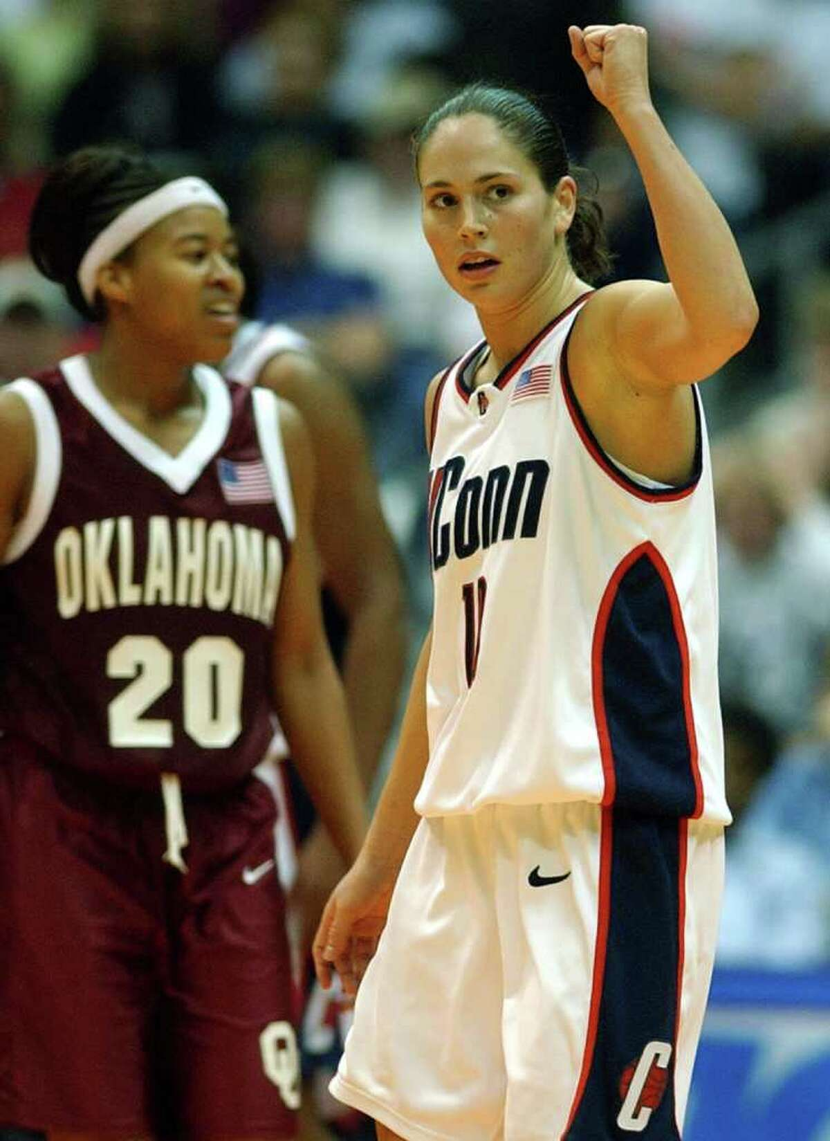 Pictured: UConn's Sue Bird raises her fist after a good play as OU LaNeishea Caulfield looks on during the second half at the Alamodome in San Antonio on Sunday, Mar. 31, 2002. (Kin Man Hui/staff)