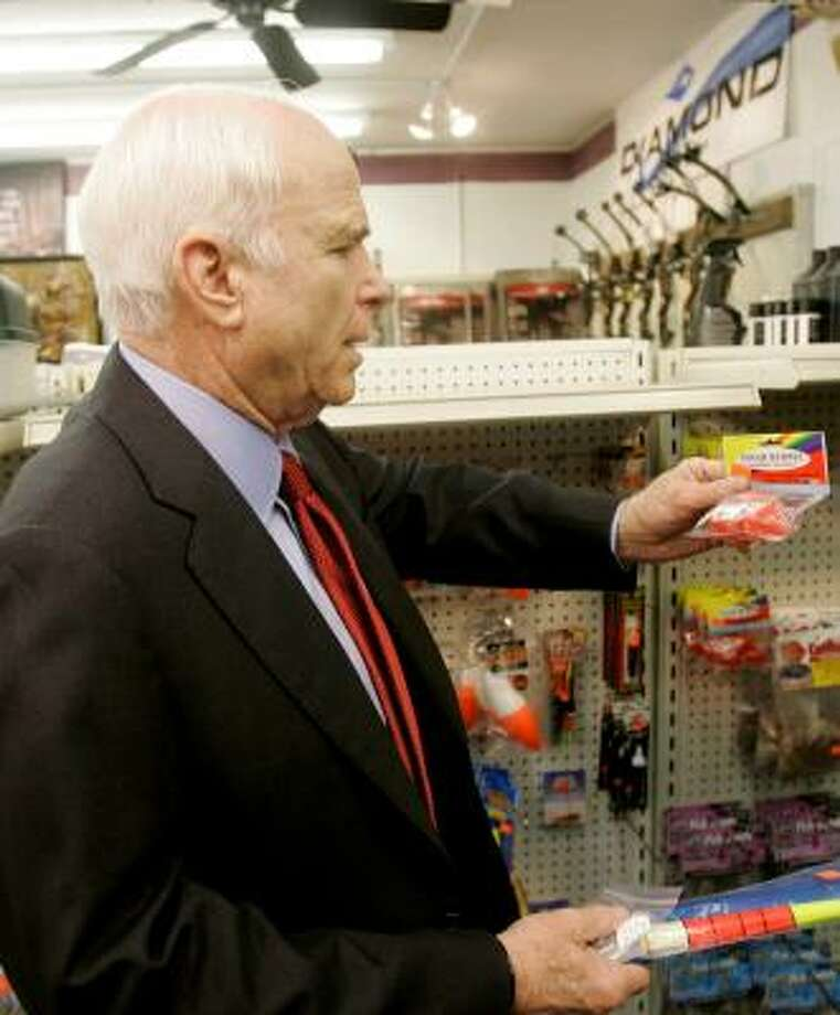 Sen. John McCain examines fishing supplies at St. Albans Gun and Archery store in Charleston, W.Va. Photo: JEFF CHIU, ASSOCIATED PRESS