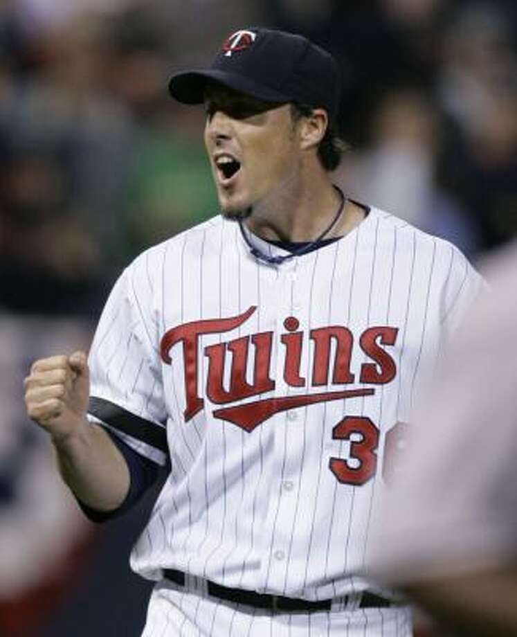 Twins closer Joe Nathan celebrates after getting Baltimore's Melvin Mora to ground out to seal Minnesota's win. Photo: JIM MONE, ASSOCIATED PRESS