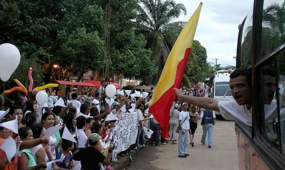 Residents of the village of Concordia, Colombia, are shown May 24 welcoming human rights activists and relatives of those kidnapped by the Revolutionary Armed Forces of Colombia. The group was on its way to El Retorno, the rebels' region of control, to carry out demonstrations. Photo: INALDO PEREZ, AFP/GETTY IMAGES