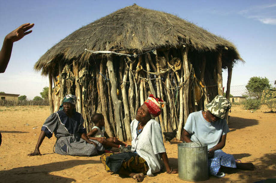 Women of the Basarwa tribe rest by their hut in the Kaudwane settlement outside the Central Kalahari Game Reserve in Botswana. The southern Africa country is the world's largest diamond producer. Photo: JEROME DELAY, AP